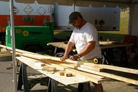 Terry Smolinski measures a board he will use for a stage platform.