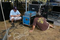 Andy McCarty (left) and Bobby Lacey hook up sound equipment at the Ukrop's/First Market Stage.