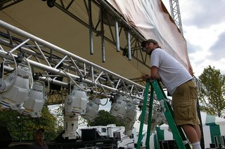 Stephen Bristow checks the lighting equipment at the Ukrop's/First Market State