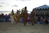 The Virginia Intertribal Dance Group and Drum begins its performance.